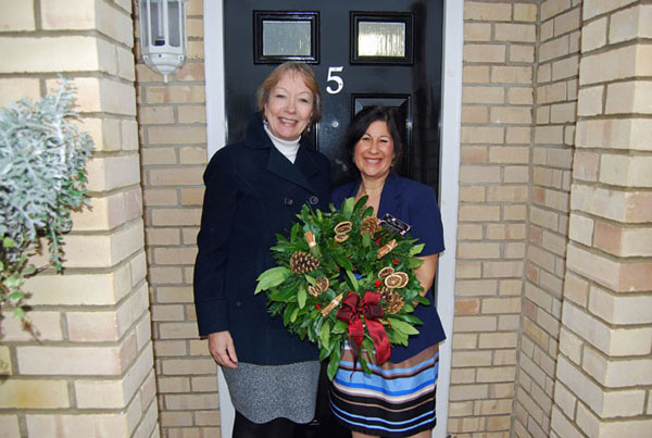 Dr. Corinne Kay receiving her Christmas wreath